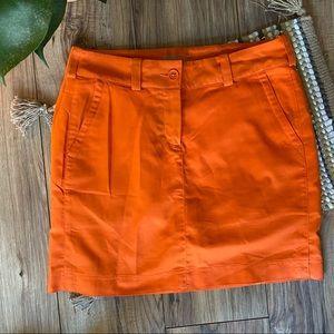 Nike orange golf mini skirt
